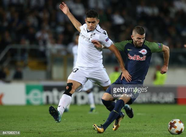 Salzburg midfielder Valon Berisha from Kosovo with Vitoria Guimaraes midfielder Guilherme Celis from Colombia in action during the UEFA Europa League...