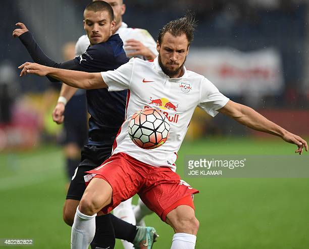 Salzburg's Andreas Ulmer and Malmo's Vladimir Rodic fight for a ball during the UEFA Champions League third qualifying round first leg football match...
