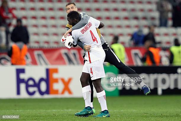 Salzburg's French defender Dayot Upamecano celebrates with a teammate after winning the Europa League football match between OGC Nice and FC Salzburg...