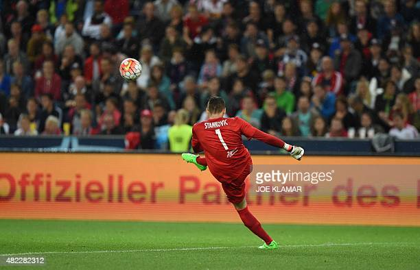 Salzburg's goalkeeper Cican Stankovic kicks a ball during the UEFA Champions League third qualifying round first leg football match between FC Red...