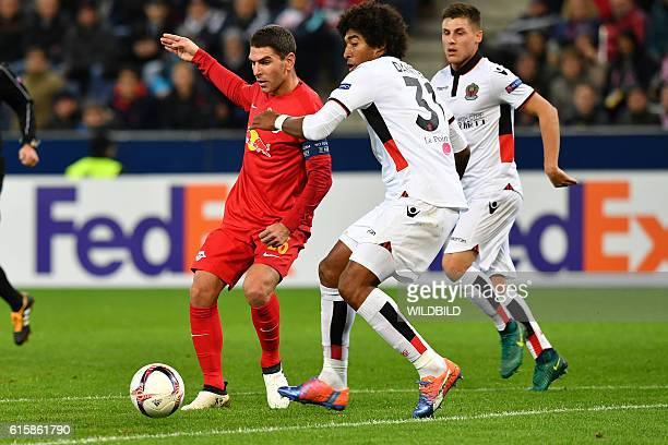 Salzburg's Jonathan Soriano and Nice's Dante vie for the ball during Europa League football match FC Salzburg v OGC Nice in Salzburg on October 20...