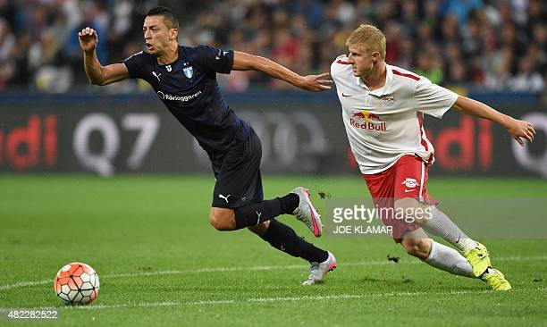 Salzburg's Martin Hinteregger and Malmo's Nikola Djurdjic fight for a ball during the UEFA Champions League third qualifying round first leg football...