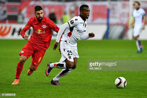 Salzburg's Munas Dabbur and Nice's Wylan Cyprien vie for the ball during Europa League football match FC Salzburg v OGC Nice in Salzburg on October...