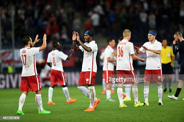 Salzburg's players celebrate after the UEFA Champions League third qualifying round first leg football match between FC Red Bull Salzburg and Malmo...