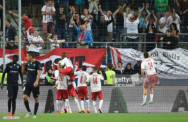 Salzburg's players celebrate the 20 penalty goal during the UEFA Champions League third qualifying round first leg football match between FC Red Bull...
