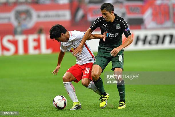 Salzburg's Takumi Minamino and Krasnodar's Odil Akhmedov vie for the ball during the UEFA Europa League Group I football match Salzburg v Krasnodar...