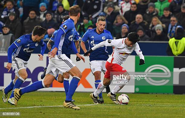 Salzburg's Takumi Minamino runs with the ball during the UEFA Europa League Group I football match between FC Salzburg and FC Schalke 04 in Salzburg...