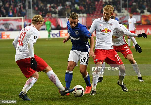 Salzburg's Xaver Schlager and Konrad Laimer vie for the ball with Schalke's forward Donis Avdijaj jduring the UEFA Europa League Group I football...
