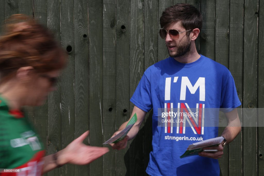 Sam, a campaigner for 'Britain Stronger in Europe' the official 'Remain' campaign for the forthcoming EU referendum, hands out leaflets outside the London vs Mayo Gaelic Athletic Association (GAA) football game at Ruislip GAA grounds in Ruislip, northwest London, on May 29, 2016. / AFP / DANIEL
