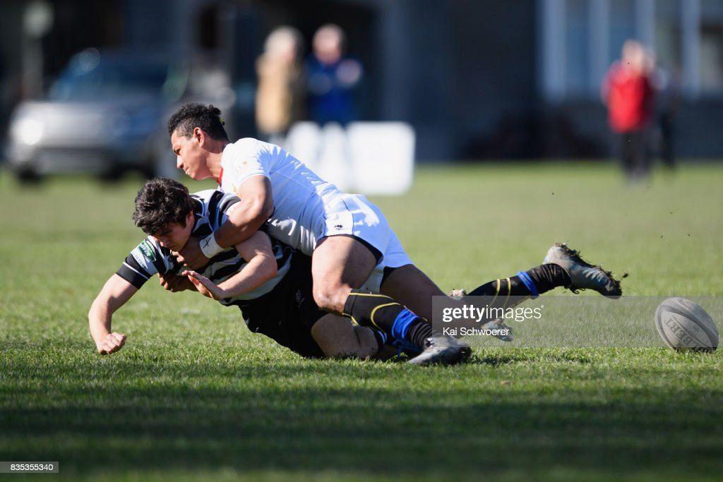 Sam Abbot of Christ's College is tackled by Tevita Eukaliti of Timaru during the Christchurch High School Semi Final match between Christ's College and Timaru Boys' High School on August 19, 2017 in Christchurch, New Zealand.