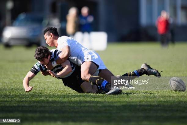 Sam Abbot of Christ's College is tackled by Tevita Eukaliti of Timaru during the Christchurch High School Semi Final match between Christ's College...