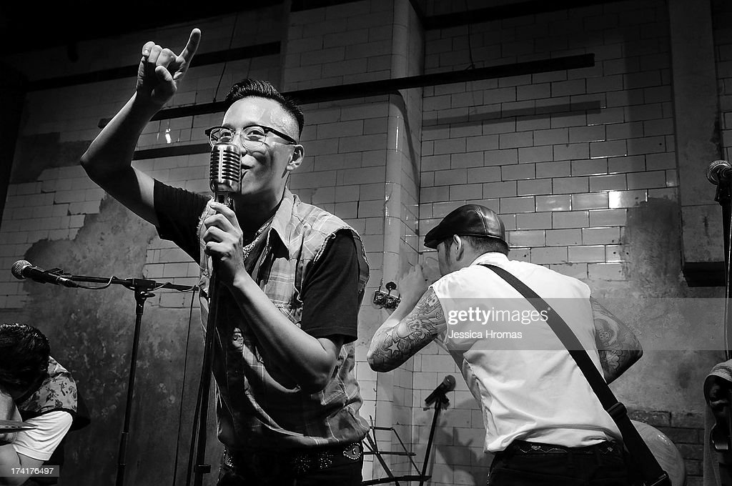 Sam Ah Chin lead singer of Taiwanese Rockabilly band Sugar Lady belts out a song during the Dirty Boogie Rockabilly Festival at the Fringe Club on July 20, 2013 in Hong Kong, Hong Kong.