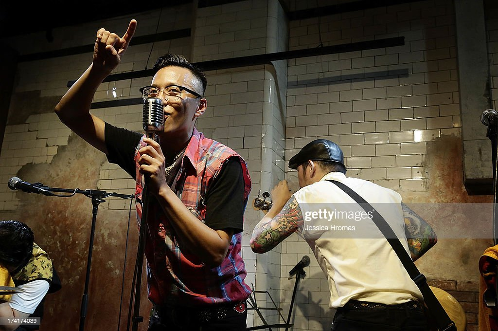 Sam Ah Chin lead singer of Taiwanese Rockabilly band Sugar Lady sings a song during the Dirty Boogie Rockabilly Festival at the Fringe Club on July 20, 2013 in Hong Kong, Hong Kong.