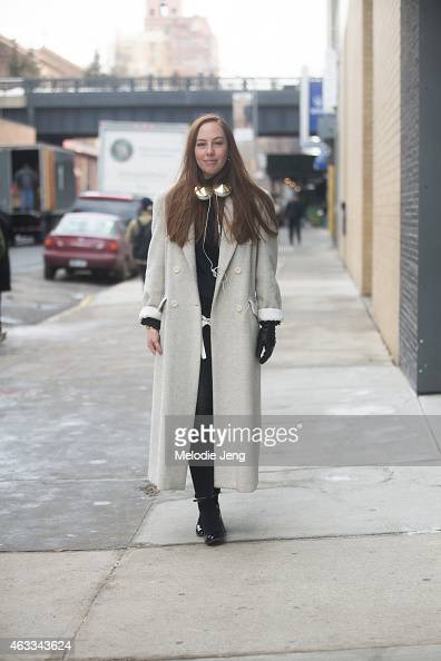 Sam Aldenton of WGSN wears a vintage coat Zara jeans and Wittner shoes at Streets of Manhattan on February 12 2015 in New York City