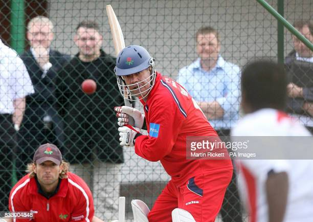 Sam Allardyce faces Sri Lankan bowler Muttiah Muralitharan in the nets during the PFA Centenary launch at Old Trafford Manchester