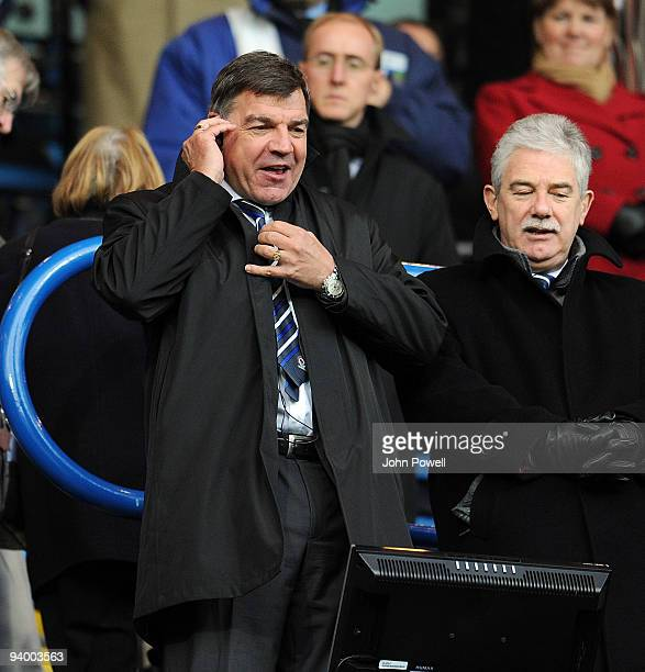 Sam Allardyce manager of Blackburn Rovers speaks on the phone ot the assistant manager during the Barclays Premier League match between Blackburn...