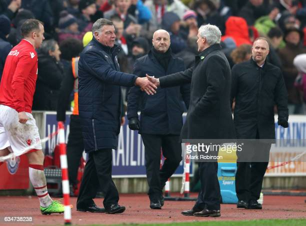 Sam Allardyce Manager of Crystal Palace and Mark Hughes Manager of Stoke City shake hands after the Premier League match between Stoke City and...