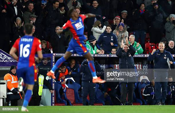 Sam Allardyce Manager of Crystal Palace celebrates as Wilfried Zaha scores his side's first goal during the Premier League match between Crystal...