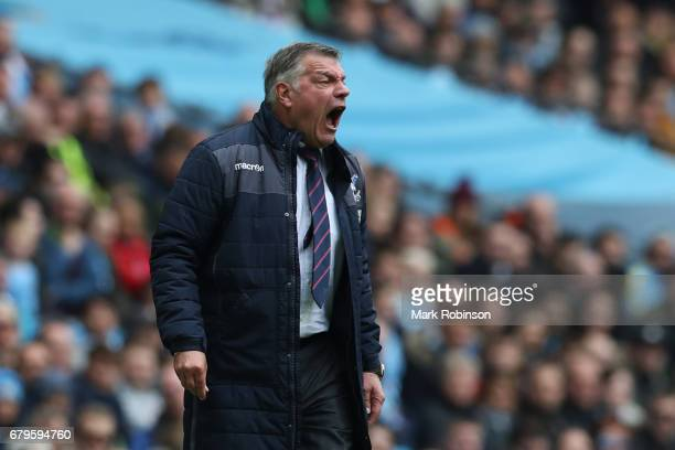 Sam Allardyce Manager of Crystal Palace gives his team instructions during the Premier League match between Manchester City and Crystal Palace at the...