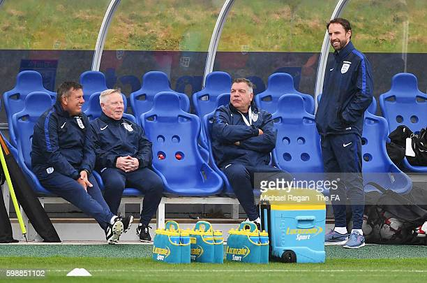 Sam Allardyce manager of England talks with assistant manager Sammy Lee Craig Shakespeare and Gareth Southgate during a training session at St...