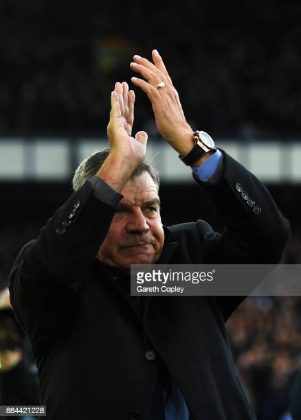 Sam Allardyce Manager of Everton shows appreciation to the fans prior to the Premier League match between Everton and Huddersfield Town at Goodison...