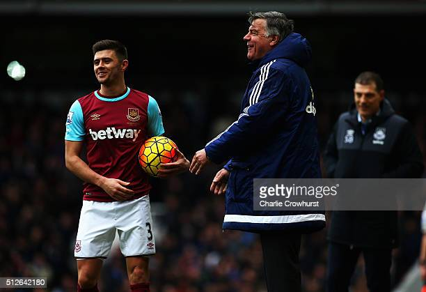 Sam Allardyce manager of Sunderland holds the ball Aaron Cresswell of West Ham United wants during the Barclays Premier League match between West Ham...