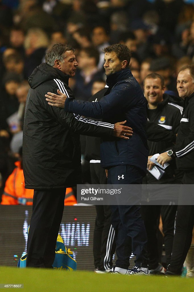 <a gi-track='captionPersonalityLinkClicked' href=/galleries/search?phrase=Sam+Allardyce&family=editorial&specificpeople=214691 ng-click='$event.stopPropagation()'>Sam Allardyce</a> manager of West Ham United (L) and <a gi-track='captionPersonalityLinkClicked' href=/galleries/search?phrase=Tim+Sherwood&family=editorial&specificpeople=4503354 ng-click='$event.stopPropagation()'>Tim Sherwood</a> interim manager of Tottenham Hotspur shake hands after the Capital One Cup Quarter-Final match between Tottenham Hotspur and West Ham United at White Hart Lane on December 18, 2013 in London, England.