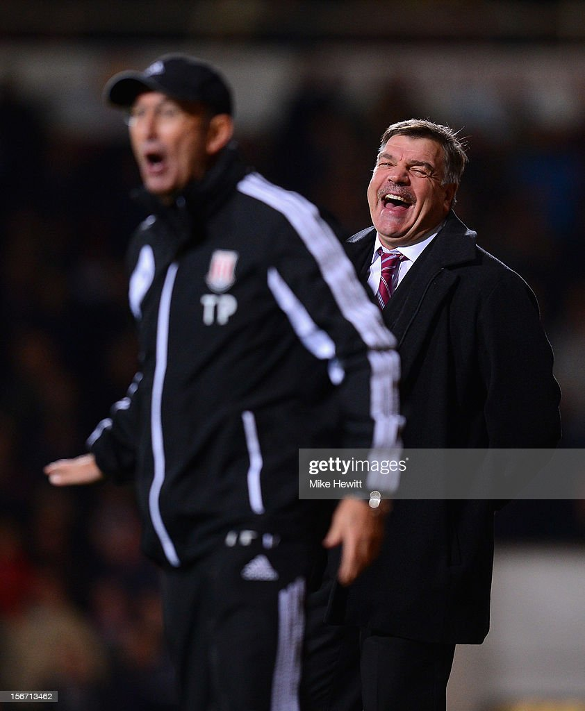 <a gi-track='captionPersonalityLinkClicked' href=/galleries/search?phrase=Sam+Allardyce&family=editorial&specificpeople=214691 ng-click='$event.stopPropagation()'>Sam Allardyce</a> (R), manager of West Ham United laughs with <a gi-track='captionPersonalityLinkClicked' href=/galleries/search?phrase=Tony+Pulis&family=editorial&specificpeople=2225291 ng-click='$event.stopPropagation()'>Tony Pulis</a>, manager of Stoke City during the Barclays Premier League match between West Ham United and Stoke City at the Boleyn Ground on November 19, 2012 in London, England.