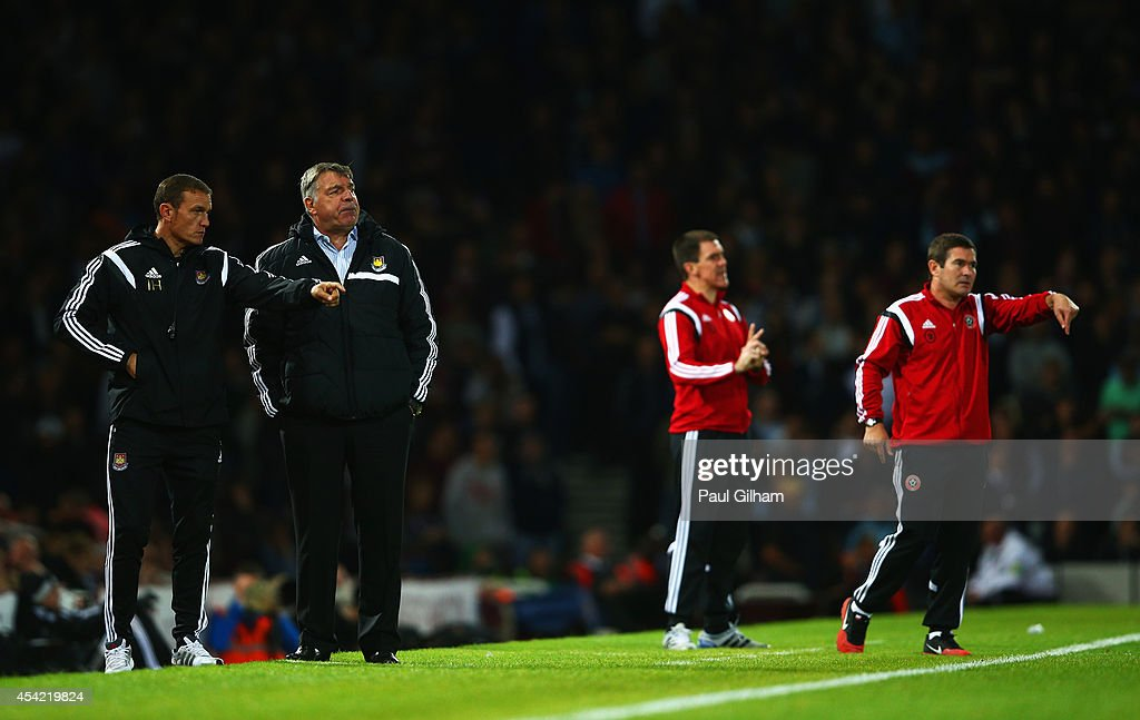 <a gi-track='captionPersonalityLinkClicked' href=/galleries/search?phrase=Sam+Allardyce&family=editorial&specificpeople=214691 ng-click='$event.stopPropagation()'>Sam Allardyce</a> (2ndL), manager of West Ham United looks on with <a gi-track='captionPersonalityLinkClicked' href=/galleries/search?phrase=Nigel+Clough&family=editorial&specificpeople=901071 ng-click='$event.stopPropagation()'>Nigel Clough</a> (R), manager of Sheffield United during the Capital One Cup Second Round match between West Ham United and Sheffield United at Boleyn Ground on August 26, 2014 in London, England.