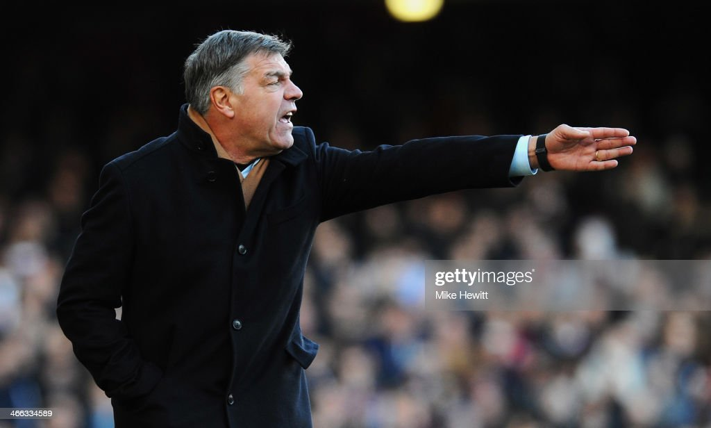 Sam Allardyce manager of West Ham United signals during the Barclays Premier League match between West Ham United and Swansea City at Boleyn Ground on February 1, 2014 in London, England.