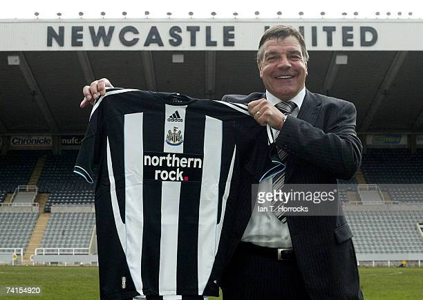 Sam Allardyce presents a Newcastle United Shirt after a press conference held at St James' Park to announce him as the new Newcastle United manager...