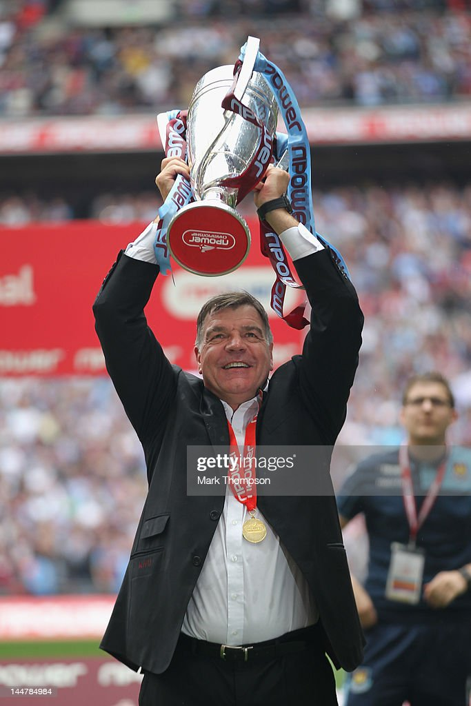 Sam Allardyce the manager of West Ham celebrates victory with the Championship trophy during the npower Championship - Playoff Final between West Ham United and Blackpool at Wembley Stadium on May 19, 2012 in London, England.