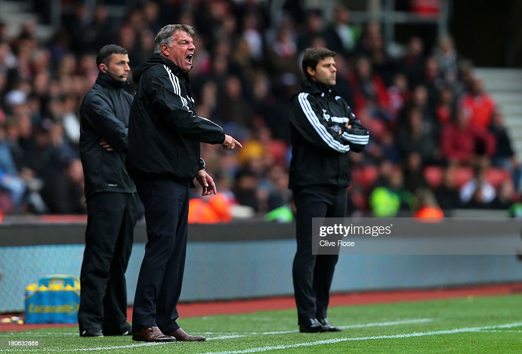 Sam Allardyce the West Ham manager reacts asMauricio Pochettino the Southampton manager looks on from the sideline during the Barclays Premier League match between Southampton and West Ham United at St Mary's Stadium on September 15, 2013 in Southampton, England.