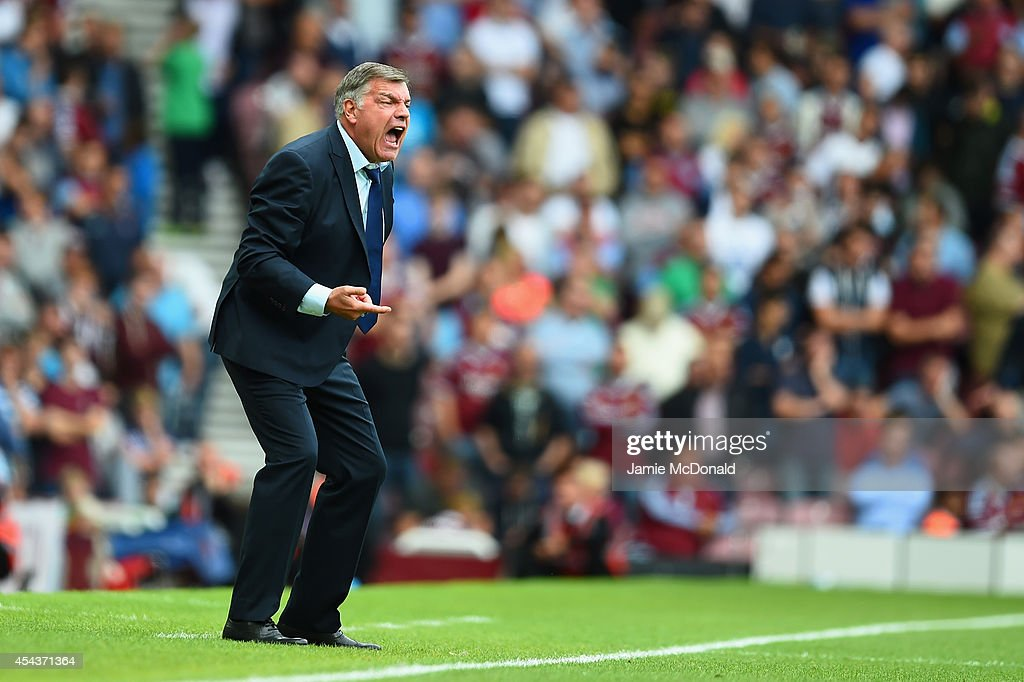 Sam Allardyce the West Ham manager reacts on the touchline during the Barclays Premier League match between West Ham United and Southampton at Boleyn Ground on August 30, 2014 in London, England.