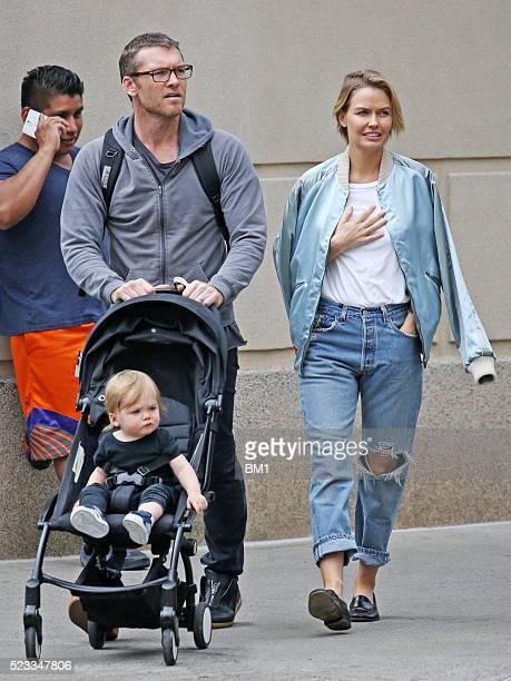 Sam and Lara Worthington and their son Rocket stroll through Manhattan on April 22 2016 in New York City