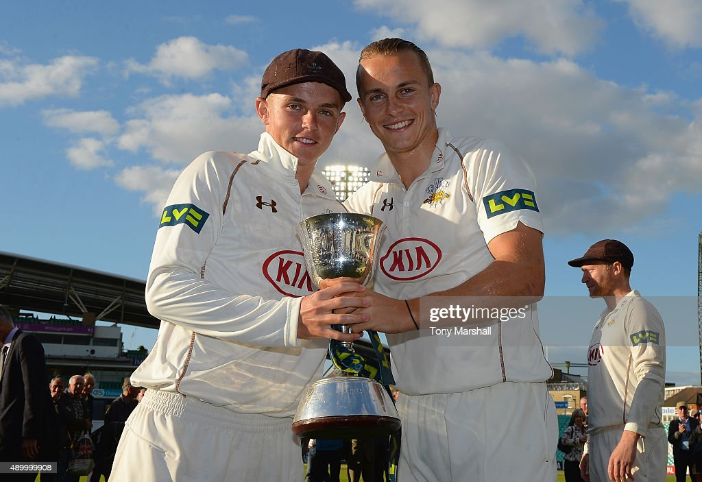 Sam and Tom Curran of Surrey celebrate with the trophy after winning of the Division 2 LV County Championship during the LV County Championship...