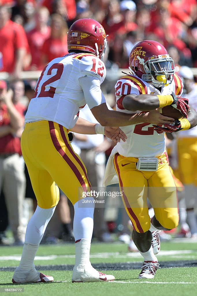 Sam B. Richardson #12 of the Iowa State Cyclones hands the ball off to DeVondrick Nealy #20 of the Iowa State Cyclones during game action on October 12, 2013 at AT&T Jones Stadium in Lubbock, Texas. Texas Tech won the game over Iowa State 42-35.