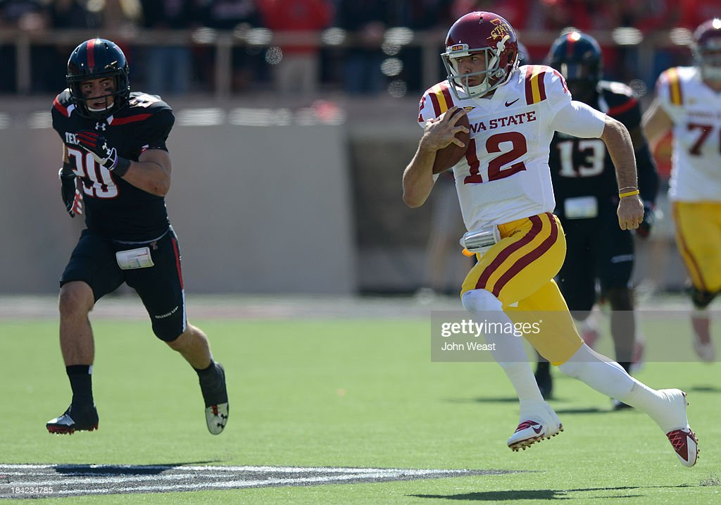 Sam B. Richardson #12 of the Iowa State Cyclones is pursued by Tanner Jackson #20 of the Texas Tech Red Raiders during game action on October 12, 2013 at AT&T Jones Stadium in Lubbock, Texas. Texas Tech won the game over Iowa State 42-35.