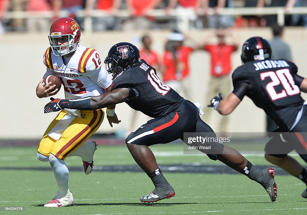 Sam B. Richardson #12 of the Iowa State Cyclones is tackled by Micah Awe #18 of the Texas Tech Red Raiders during game action on October 12, 2013 at AT&T Jones Stadium in Lubbock, Texas. Texas Tech won the game over Iowa State 42-35.