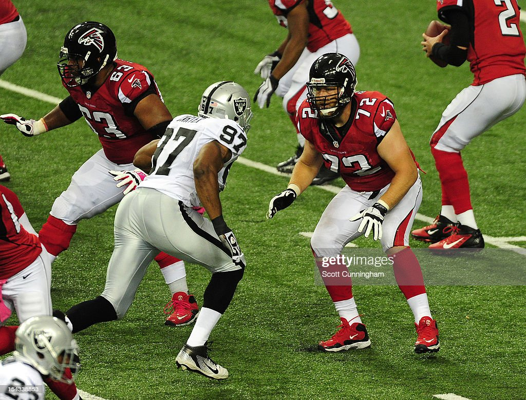Sam Baker #72 of the Atlanta Falcons blocks against <a gi-track='captionPersonalityLinkClicked' href=/galleries/search?phrase=Andre+Carter&family=editorial&specificpeople=213649 ng-click='$event.stopPropagation()'>Andre Carter</a> #97 of the Oakland Raiders at the Georgia Dome on October 14, 2012 in Atlanta, Georgia