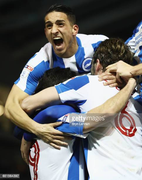 Sam Baldock of Brighton and Hove Albion is mobbed by team mates Anthony Knockaert and Dale Stephens in celebration as he scores their second goal...