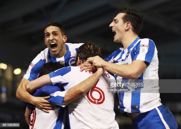 Sam Baldock of Brighton and Hove Albion is mobbed by team mates in celebration as he scores their second goal during the Sky Bet Championship match...