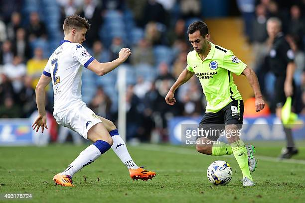 Sam Baldock of Brighton Hove Albion FC maintains control of the ball over Sam Byram of Leeds United FC during the Sky Bet Championship match between...
