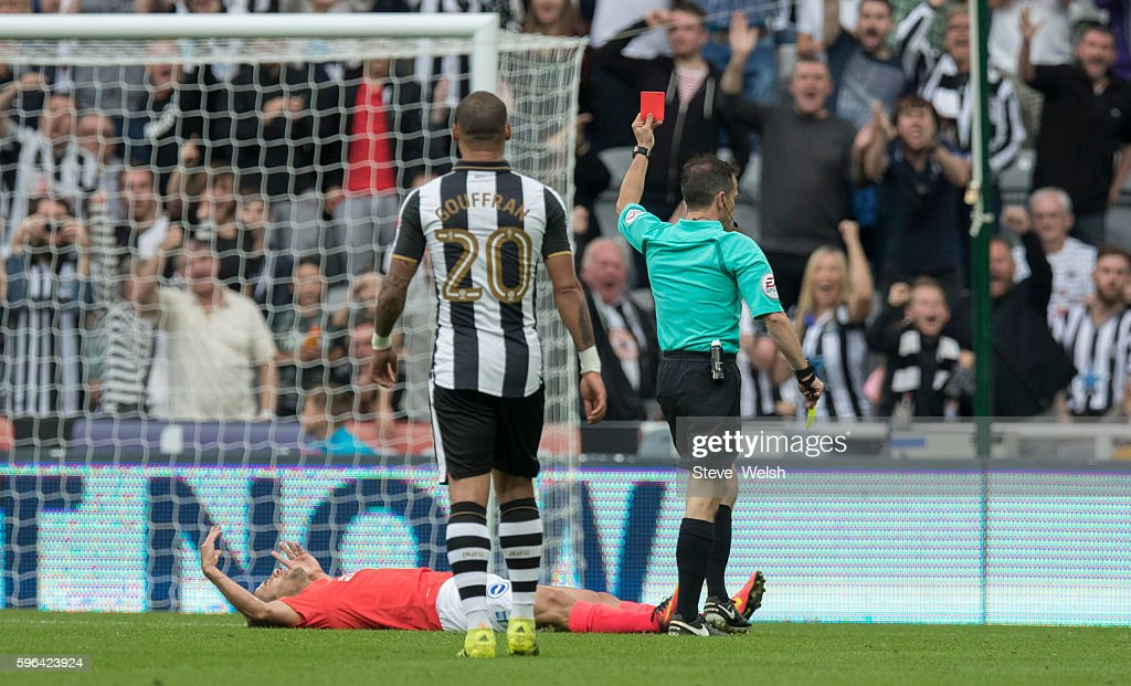 Sam Baldock of Brighton is shown a red card by Referee Keith Stroud after a second yellow during the Premier League match between Newcastle United and Brighton & Hove Albion on August 27, 2016 in Newcastle.