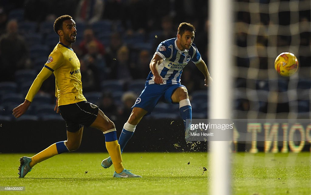 Sam Baldock of Brighton shoots wide as <a gi-track='captionPersonalityLinkClicked' href=/galleries/search?phrase=James+Perch&family=editorial&specificpeople=2211397 ng-click='$event.stopPropagation()'>James Perch</a> of Wigan looks on during the Sky Bet Championship match between Brighton & Hove Albion and Wigan Athletic at Amex Stadium on November 4, 2014 in Brighton, England.