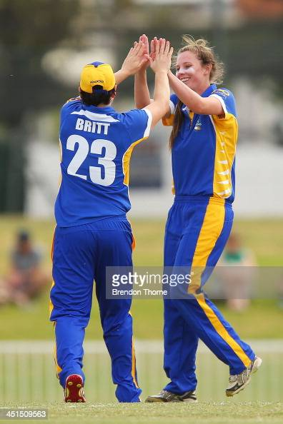 Sam Bates of ACT celebrates with team mate Kris Britt after claiming the wicket of Alex Blackwell of NSW during a WNCL match between ACT and New...