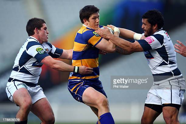 Sam Beard of Bay of Plenty is tackled by Piri Weepu of Auckland during the round three ITM Cup match between Auckland and the Bay Of Plenty at Eden...