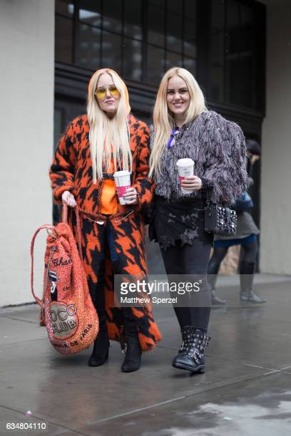 Sam Beckerman and Cailli Beckerman are seen attending Ryan Roche during New York Fashion Week wearing a black and orange coat and grey fringe coat on...