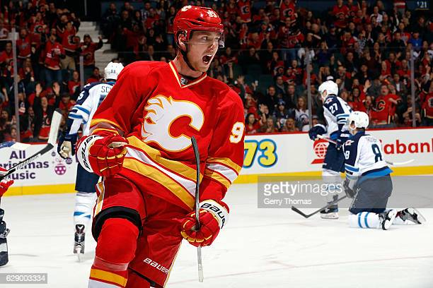 Sam Bennett and teammates of the Calgary Flames celebrate a goal against the Winnipeg Jets during an NHL game on December 10 2016 at the Scotiabank...