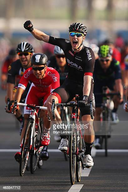 Sam Bennett of Ireland and the BoraArgon 18 team celebrates winning stage six of the 2015 Tour of Qatar a 1135km road stage from Sealine Beach Resort...